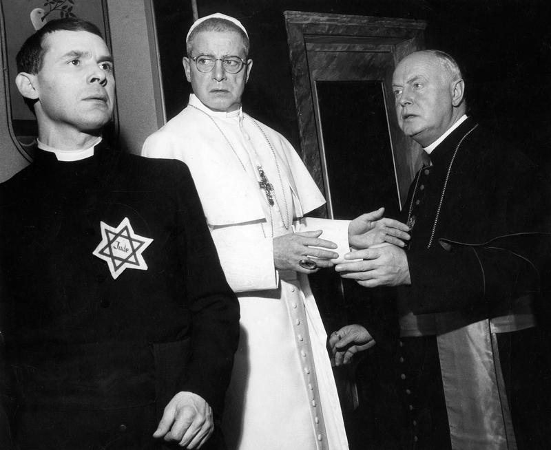 "Actor Dieter Borsche as the pope in the play ""The Deputy,"" by Rolf Hochhuth. On the left, Guenther Tabor as ""Riccardo,"" and Hans Nielsen on the right as the Cardinal in 1963."