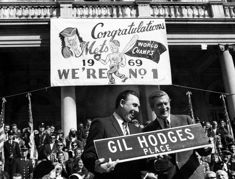 Gil Hodges (left) and Mayor John Lindsay hold up a street sign honoring the manager of the world champion New York Mets.