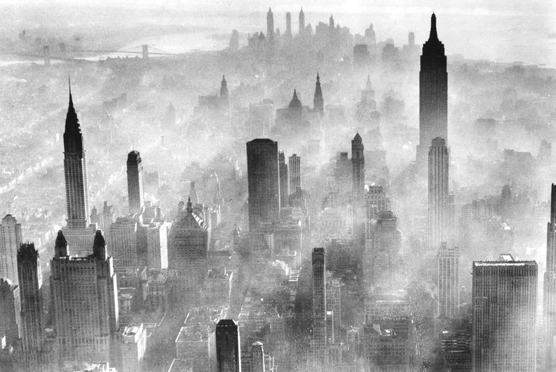 View of the city skyline partially obscured by smog, New York, 1973.