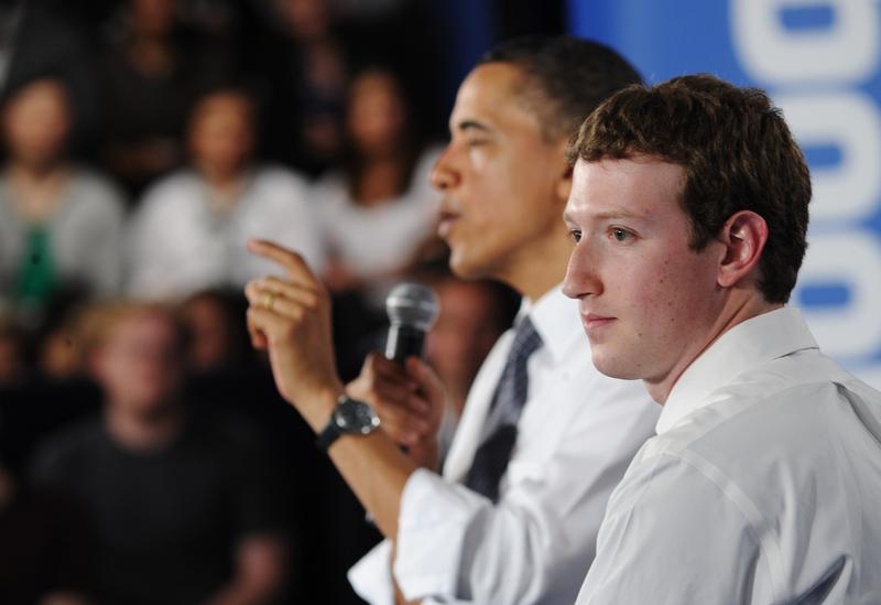 President Obama speaks as Facebook CEO Mark Zuckerberg looks on during a town hall meeting April 20, 2011 at Facebook headquarters in Palo Alto, California.
