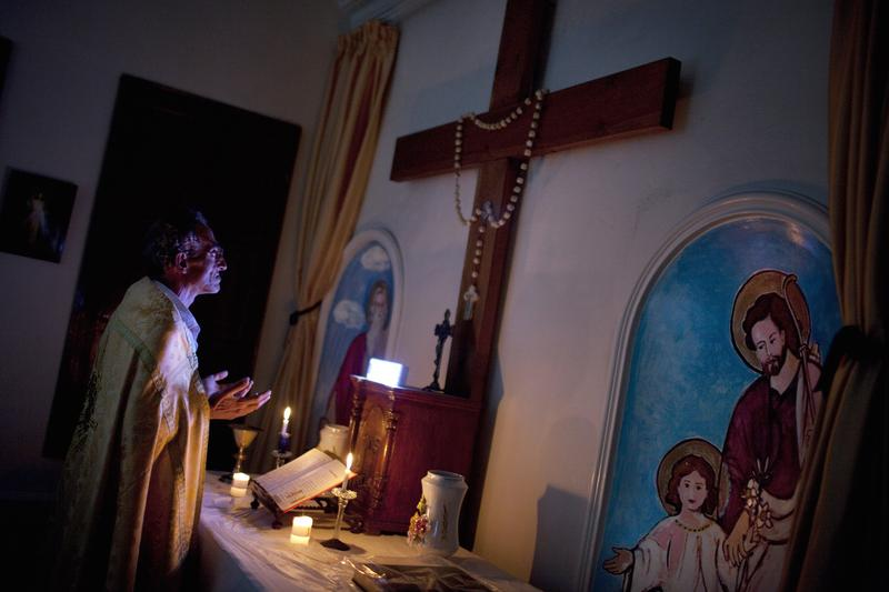 Syrian Christian Michael Oberi prays in the chapel of Mar Elias House, a church hostel for the indigent in the old City of Aleppo, on September 16, 2013.