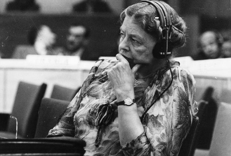 Eleanor Roosevelt, representative to the United Nations, listening through headphones during a conference at the temporary UN headquarters in Lake Success, NY.
