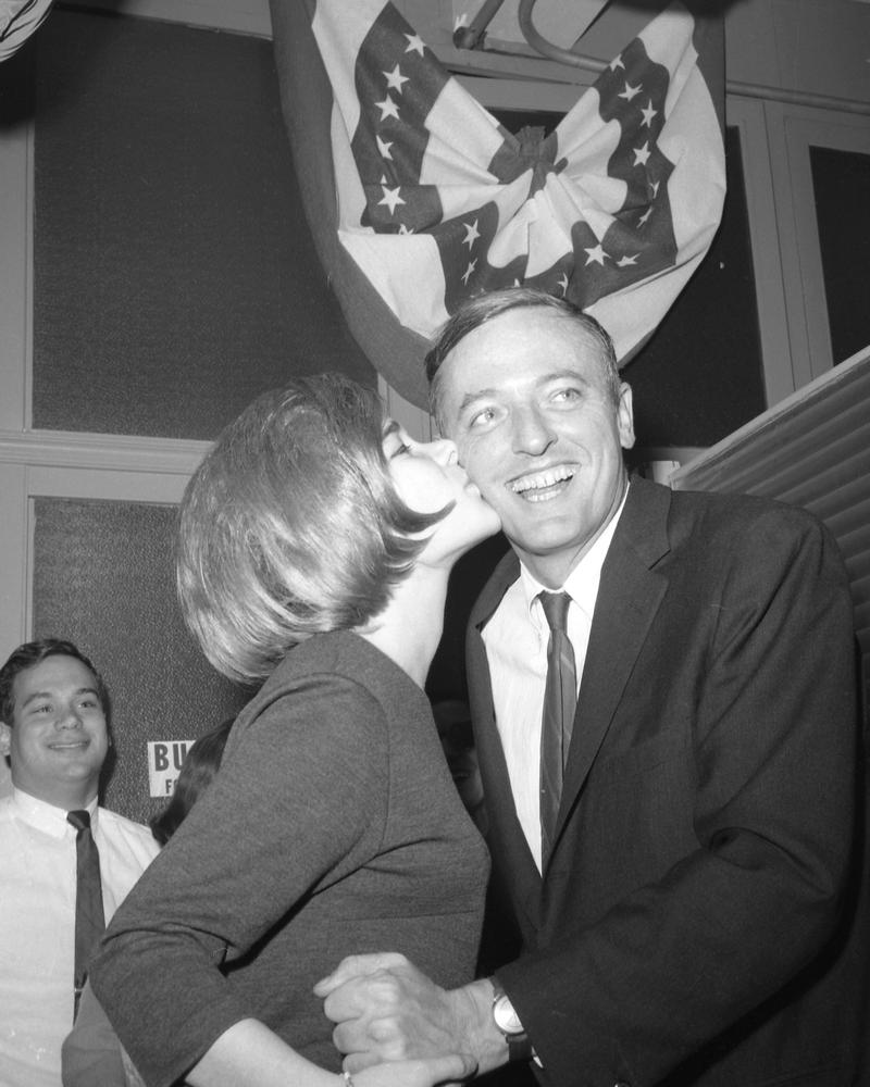 Arlene Luterman plants a kiss on Conservative Party mayoral candidate William F. Buckley at his headquarters, 25 W. 45th St, November 1, 1965.