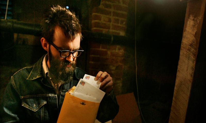 Mark Everett with his father's papers and documents, which he stores under his house