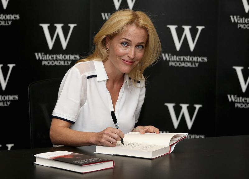 Gillian Anderson signs copies of her new book 'Vision of Fire' at Waterstone's, Piccadilly on October 3, 2014 in London, England.