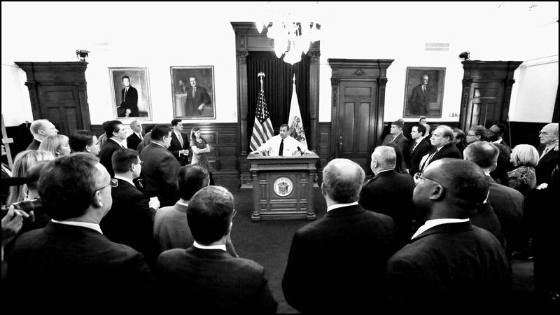 New Jersey Governor Chris Christie talks with Cabinet Senior Staff after 2015 State of the State address.