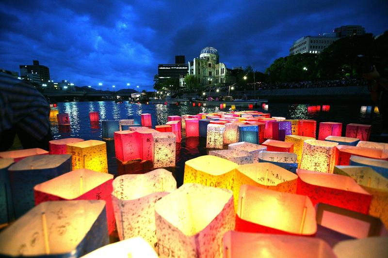Candles and paper lanterns float on the Motoyasu River in front of the Atomic Bomb Dome at the Peace Memorial Park, in memory of the victims on the 62nd anniversary of the Hiroshima bomb.