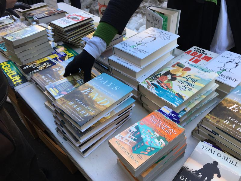 A table of books by Irish and Mexican authors, being given away for free by the Irish Arts Center on St. Patrick's Day.