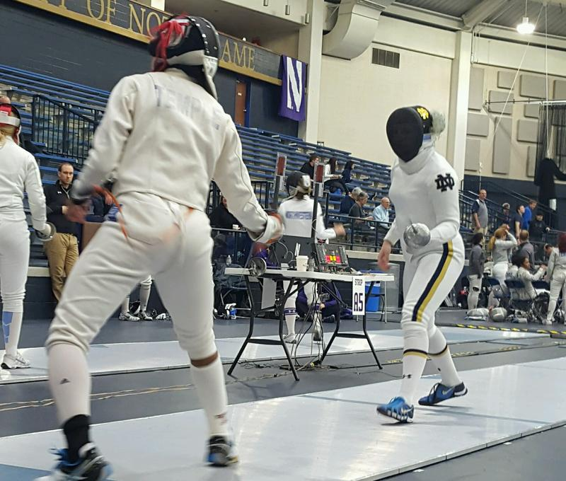 Safa Ibrahim (on left) fencing during a tournament