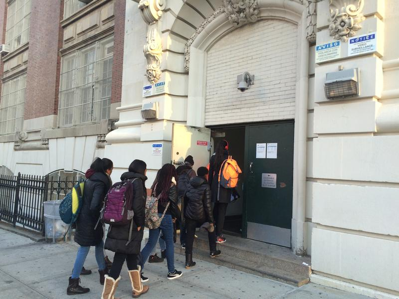 Students enter school at the John Jay campus in Park Slope, Brooklyn, a building with daily scanning.