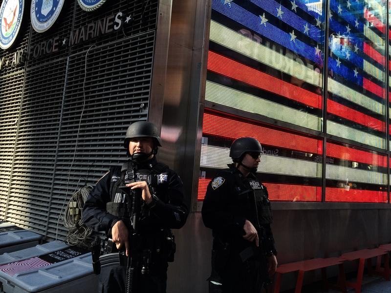 Heavily armed officers stand guard in Times Square following the terrorist attacks in Paris.