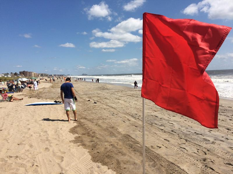 With storm Hermine offshore, red flags at Beach 120th Street in The Rockaways signal that no swimming is allowed. Beaches will be closed through at least Monday.