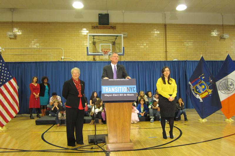 Bill de Blasio appointing Carmen Farina as Schools Chancellor at MS 51 in Brooklyn, with Ursula Ramirez (right) as her chief of staff