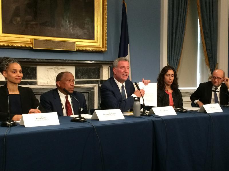 Mayor Bill de Blasio holds up memo codifying city's current policy on deed restrictions