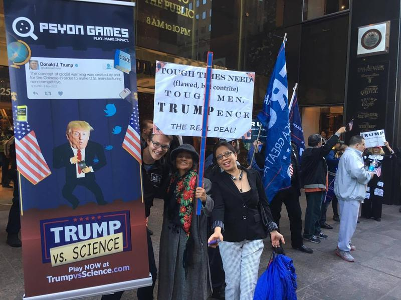 Gamer Olli Rundgren (next to sign) promotes his game at Trump Tower.