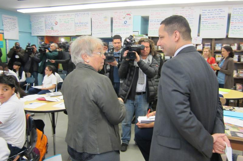 Chancellor Farina with M.S. 223 Principal Ramon Gonzalez and members of the media, visiting a class