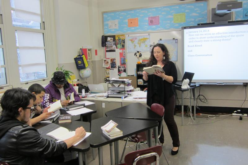 English teacher Erin Bauer helping students write an effective introduction, before the January Regents