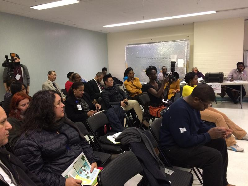 Immigrants attend a forum meant to build trust in the city's public hospitals.