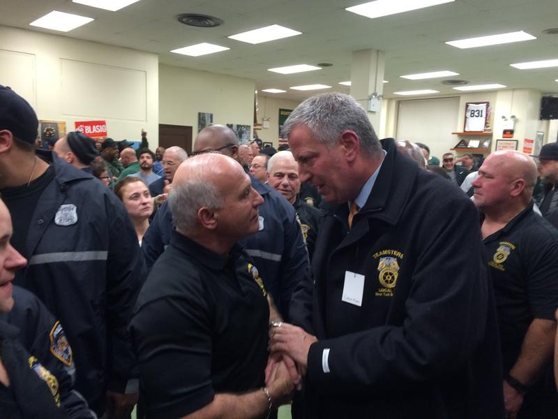 Mayor de Blasio shakes hands with members of Sanitation Workers Union, Local 831, the first union to endorse his re-election bid.