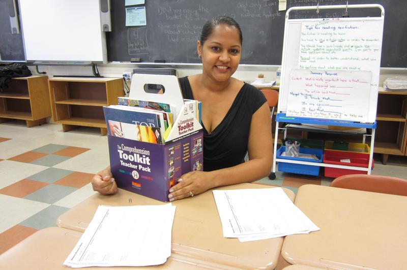 Teacher Mercedes Valentin at P.S. 24 with examples of student work from summer school and a toolkit of reading strategies