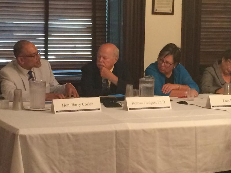 Members of a legislative pay commission meet in midtown this summer.