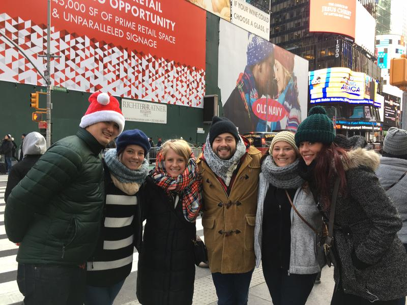 Tourists in Times Square, like this group from Virginia visiting their friend in New York, were more than happy to sing their favorite holiday songs, and their least favorites, too.
