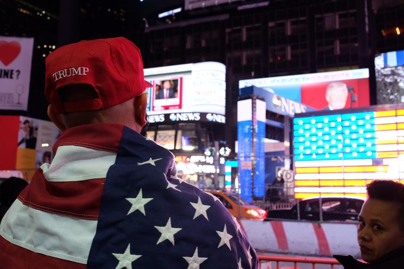 Trump and Clinton supporters watch election results in Times Square.