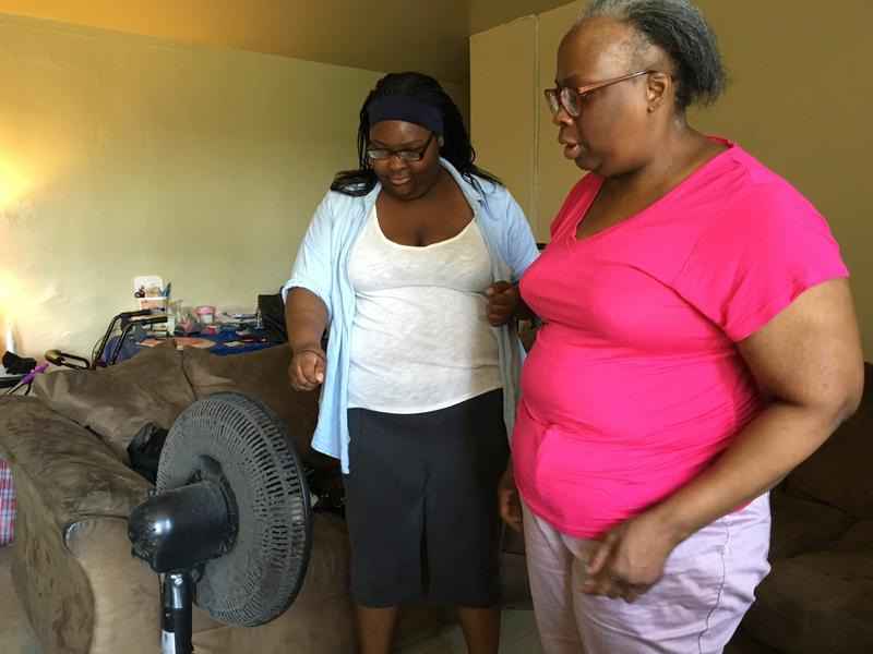 Michelle Holmes and her daughter Raelene live on the 6th floor of a public housing complex without AC. They can't afford it. (Sarah Gonzalez/WNYC)