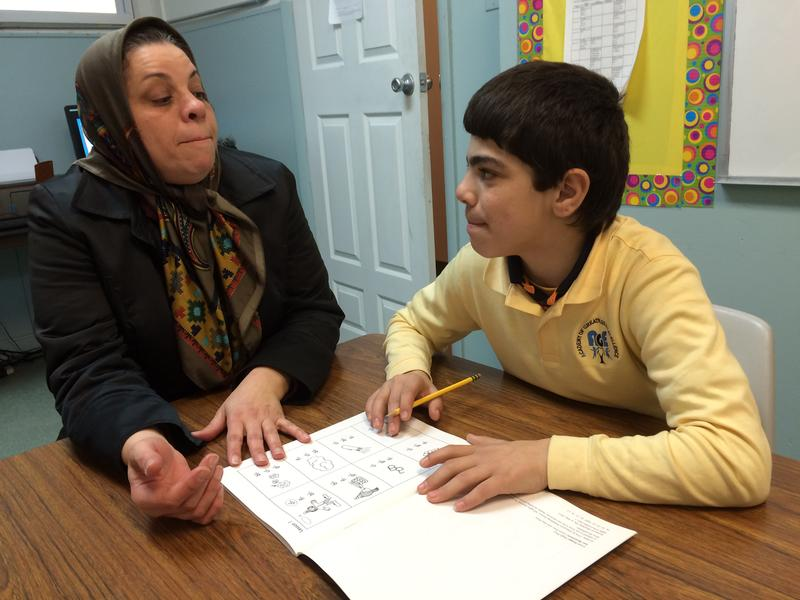 Ibraheem Al Radi (right) learning how to say English letters with Rawaa Nejad, an English as a Second Language Teacher at the Academy for Greatness and Excellence in Teaneck