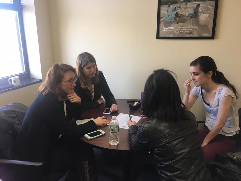 Megan Johnson, director of the Jersey City office of Church World Service, meets with members of the group Greater New York City Families for Syria.