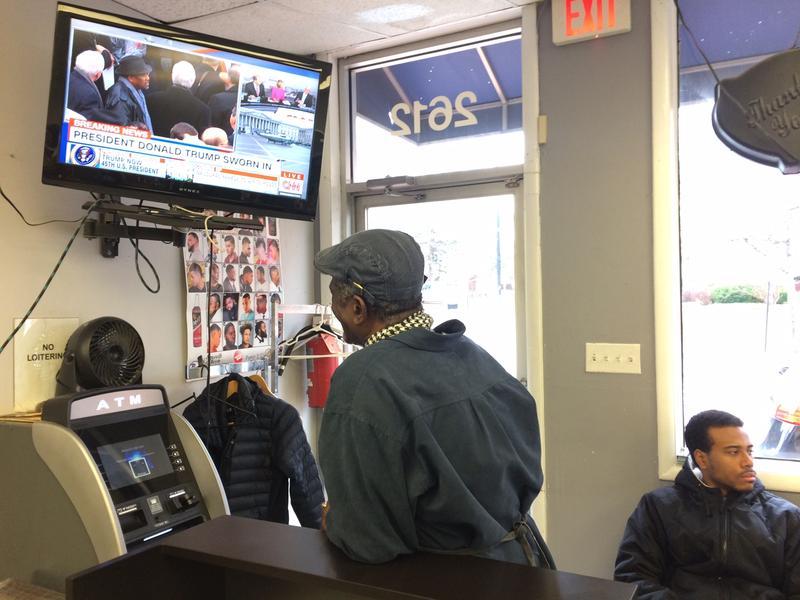 Pop watching the inauguration at a barbershop near Howard University