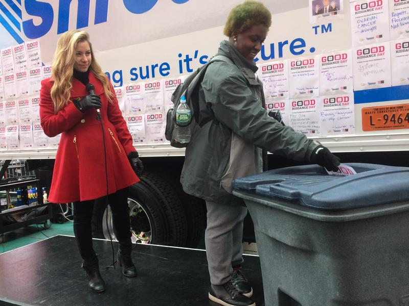 New Yorker Rebekah Byrd fed a piece of paper with a plea to stop testing on animals into a giant shredder at Times Square, symbolizing what she wanted to get rid of in 2016