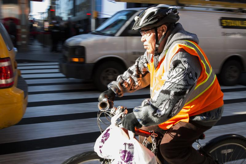 A delivery cyclist rides down 7th Avenue in Times Square during the  lunch rush. (Jack D'Isidoro)