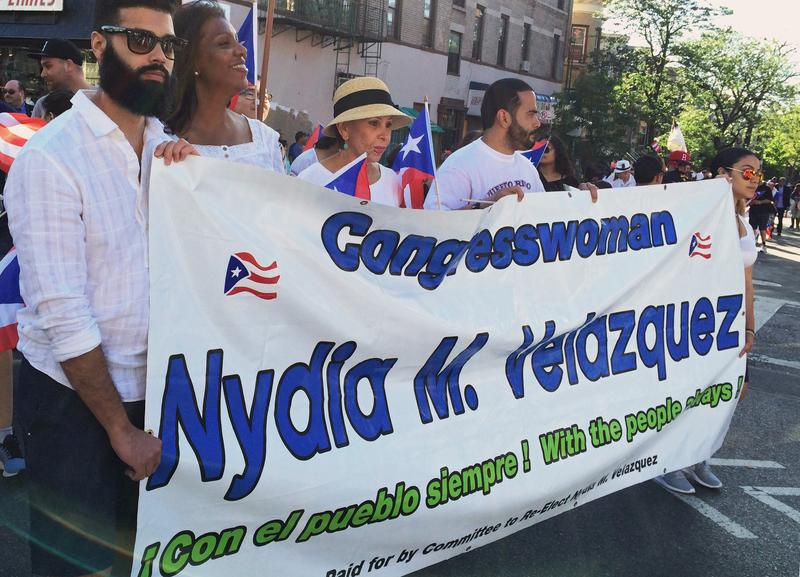 Congresswoman Nydia Velazquez (center, in hat) marches in the Sunset Park Puerto Rican Day Parade surrounded by supporters
