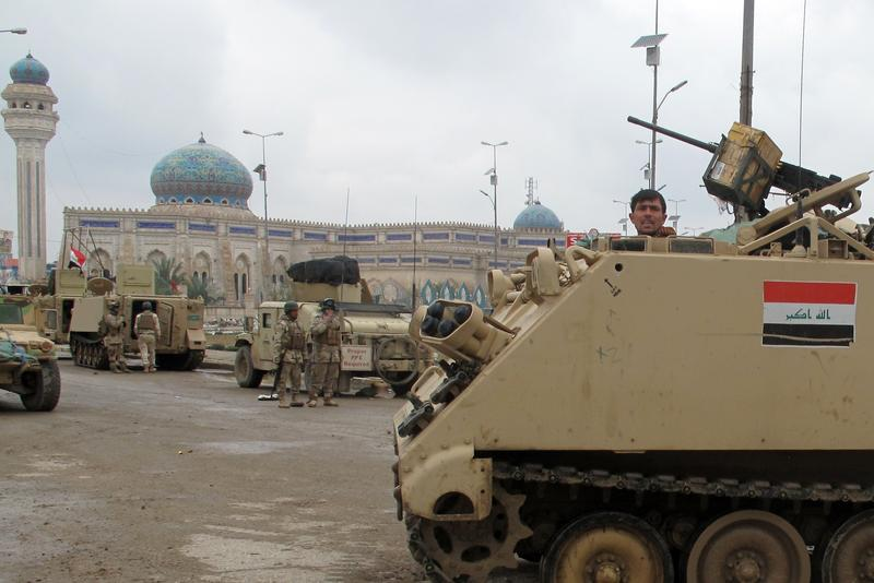 raqi security forces take position in the city of Ramadi, west of the capital Baghdad in the Anbar province, on February 4, 2014 during a military operation against anti-government fighters.