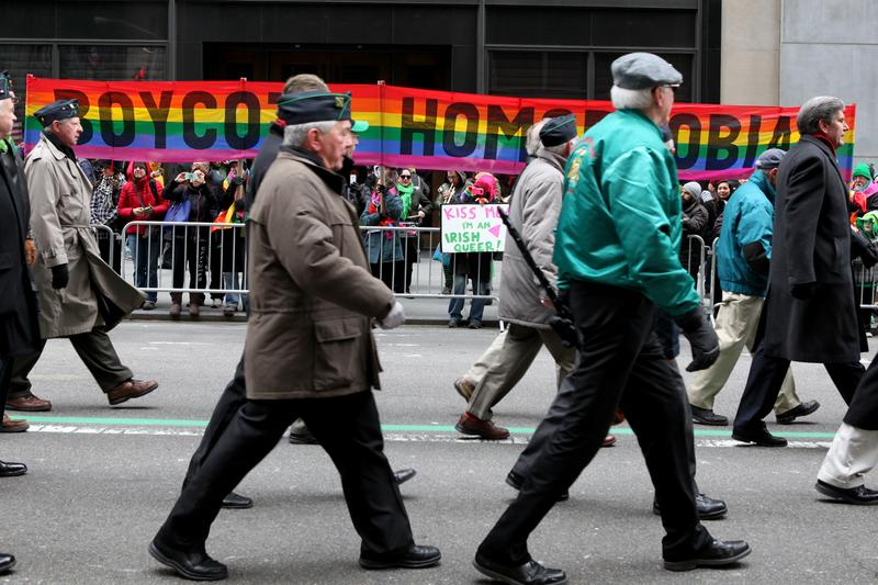 Irish groups march past anti-homophobia banners on Fifth Avenue at the St. Patrick's Day Parade on March 17, 2014.