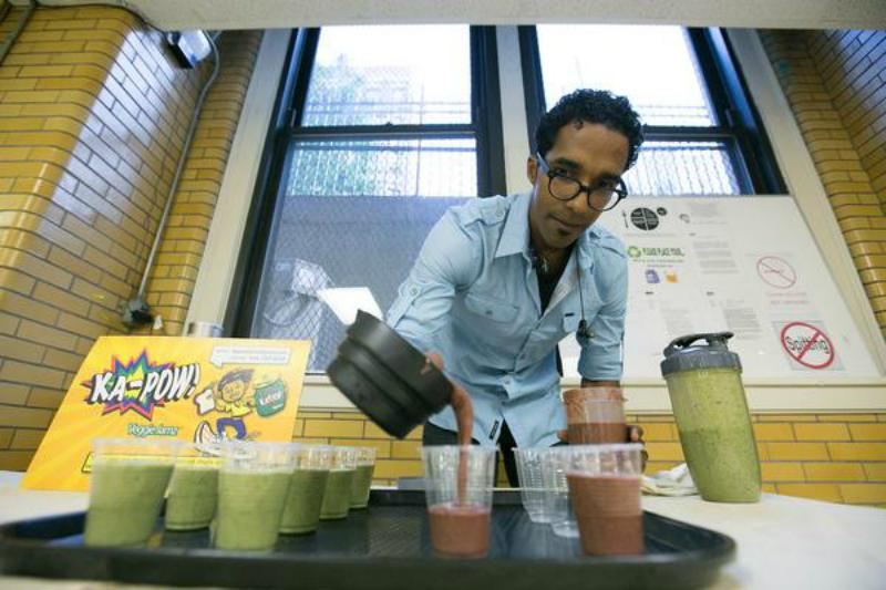 Armando Batista, Kapow creator, pouring one of his fruit and veggie concoctions.