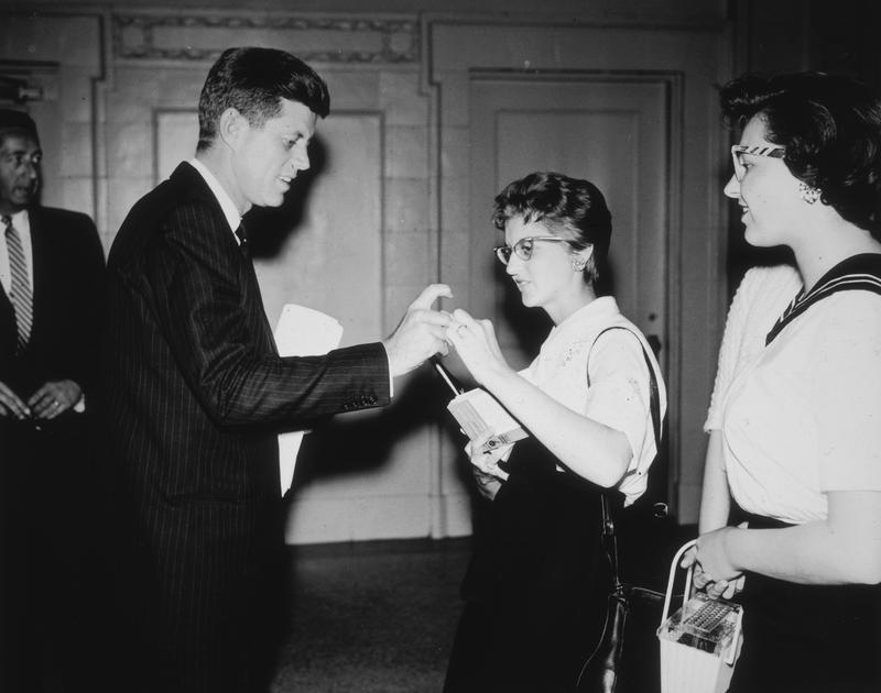 Kennedy Prepares to Sign a Copy of Profiles in Courage for a Fan