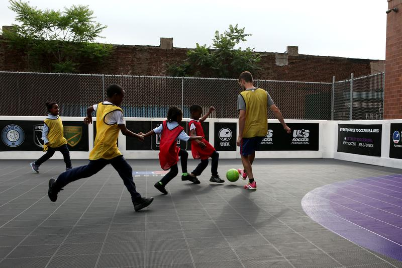 A scrimmage in East New York, led by the coaches at Street Soccer USA.