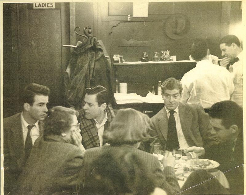 Regulars at the San Remo Café. Writer Jack Kerouac sits on the far right.