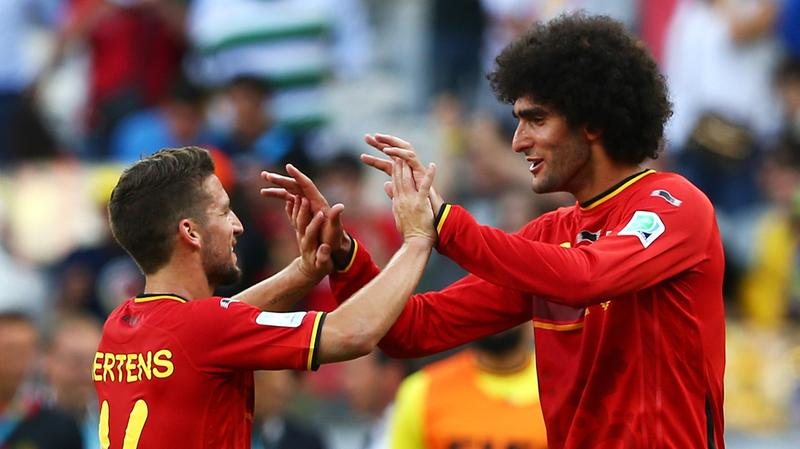 Belgium's Dries Mertens (L) and Marouane Fellaini of Belgium celebrate after defeating Algeria 2-1 during the 2014 FIFA World Cup Brazil at Estadio Mineirao on June 17, 2014 in Belo Horizonte, Brazil.