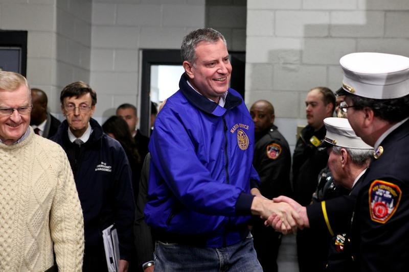 Mayor Bill de Blasio meets with EMT workers in Gowanus, Brooklyn and briefs the press on storm clean-up updates on January 22, 2014.