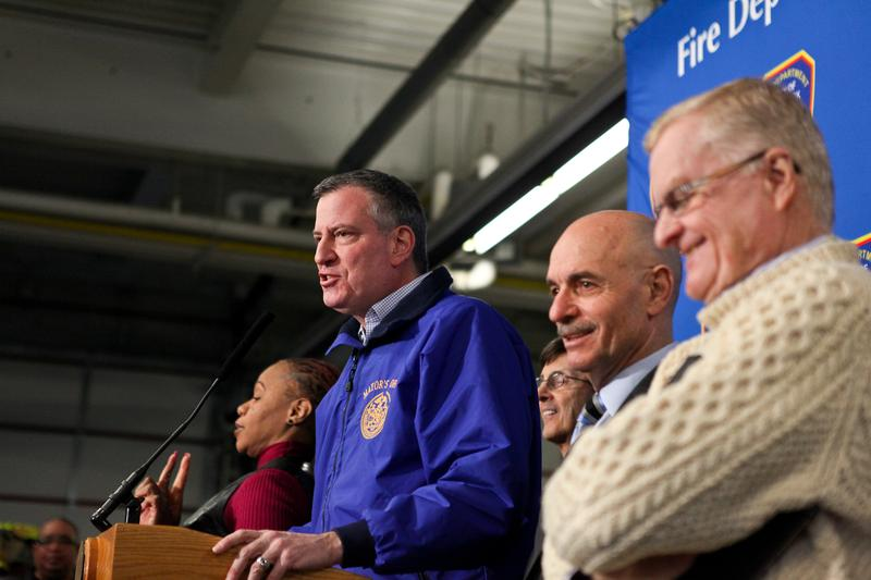 Mayor Bill de Blasio briefs the press on snow storm clean-up efforts with FDNY chief Salvatore Cassano (c) and Dept. of Sanitation head John Doherty (R).