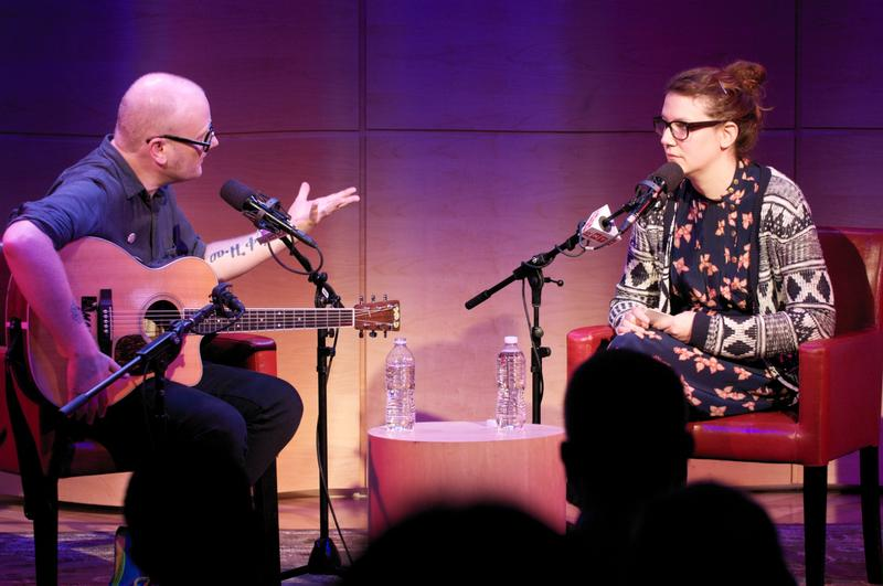 Mike Doughty and Sara Schaefer taping a special episode of LIES onstage.