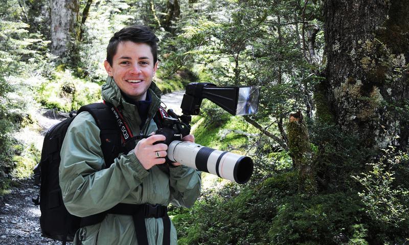 Ben Mirin photographing birds in New Zealand's Fiordland