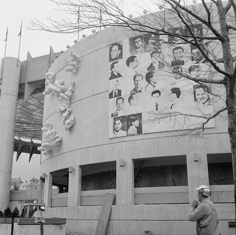Andy Warhol, Thirteen Most Wanted Men, silkscreen on canvas, 20 x 20 ft. Installed on the exterior of the New York State Pavilion.