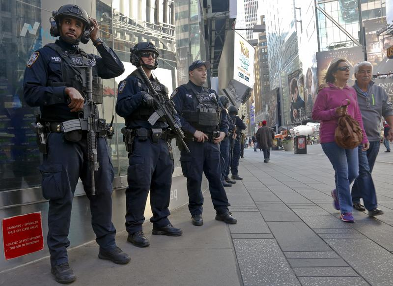 Officers from the NYPD anti-terror unit patrol Times Square.
