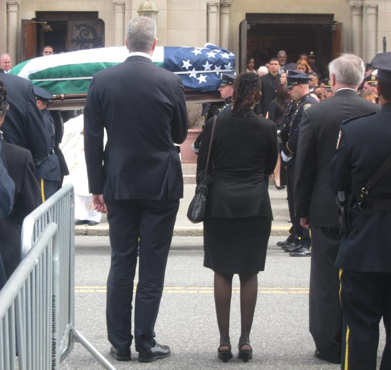 Mayor Bill de Blasio, First Lady Chirlane McCray and Police Commissioner Bill Bratton at Officer Dennis Guerra's funeral.