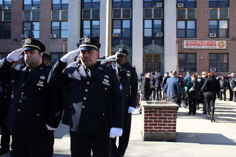 Officers at funeral for Griselde Camacho, who died in the East Harlem building explosion.