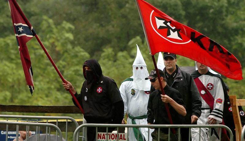 Klan members arrive at a rally in Pennsylvania 2006.